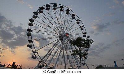 Ferris wheel with evening sun