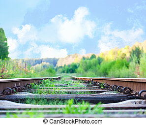 ferrocarril, a, horizonte, debajo, profundo, cielo azul, en, ocaso