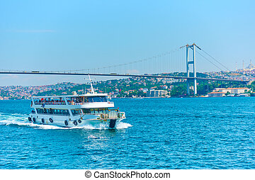 Bosporus in Istanbul - Ferry and 15 July Martyrs Bridge over...