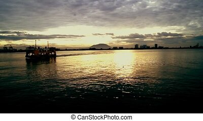 Ferry and sunset - A beautiful view of sunset and a ferry...