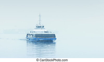 Ferry Approaching In Heavy Snowfall