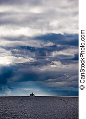 ferry boat and stormy skies - ferry boat with storm clouds
