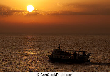 Ferry-boat at sunset