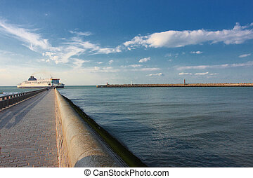ferry boat entering in the channel of the port of Calais