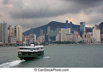 Ferry boat in Victoria Harbor, Hong Kong ,before storm...