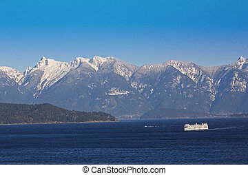 Ferry boat on the Pacific - Coastal mountains of the West...