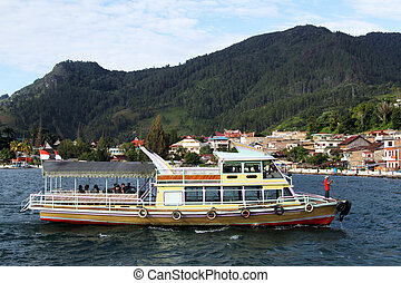 Ferry boat near pier in Parapat, Indonesia