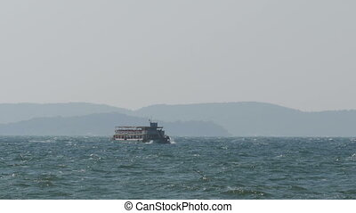 Ferry Boat with Tourists Sails on Storm Waves in the Sea. Thailand, Pattaya