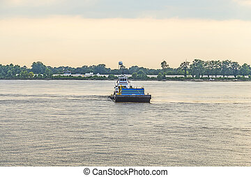 Ferry crossing Mississippi river at sunset in Baton Rouge