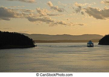 ferry crossing ocean in the evening