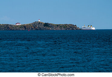 Ferry departing around Lighthouse