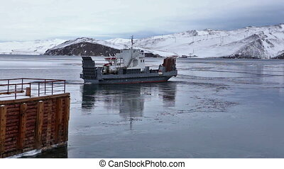 Ferry go lake Baikal in winter