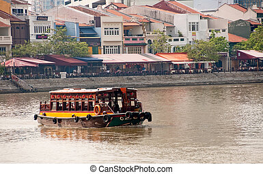 ferry in boat quay - ferrying tourists in singapore harbor...