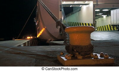 Ferry Loading Cargo During at Night - A close up shot of a...