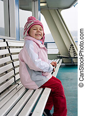 ferry - little girl siitting on the bench on the ferry