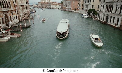 Ferry sails on the Grand Canal  in Venice, Italy