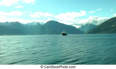 Ferry ship cruising on Norwegian fjord