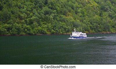 Ferry ship with passengers on Norwegian fjord. Cruise ship...