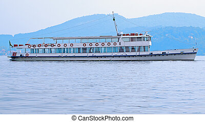 Ferry - View of a ferry navigating in a lake