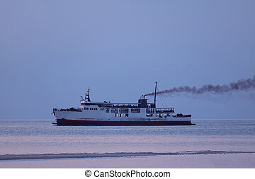 Ferry with smoke coming from stack ,Diesel engine ready to leaving from the harbor