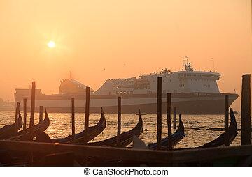 Ferryboat sailing near venetian gondolas