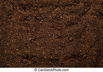 Fertile garden soil texture background top view - Fertile...