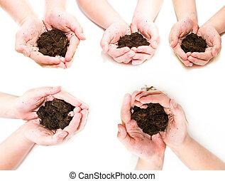 Fertile soil in hands set