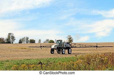 Fertilizer Sprayer - Sprayer equipment in a farm field for...