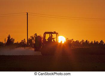 Fertilizing The Land - The man fertilizing the soil during...