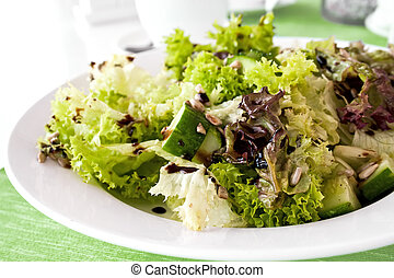 Fesh green salad with seeds and cucumbers