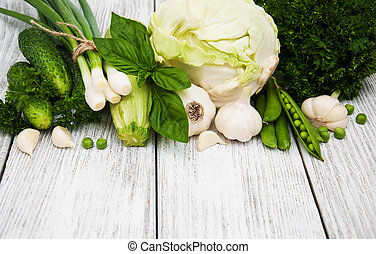 Fesh green vegetables on a old wooden background