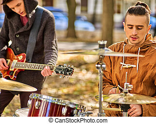 Festival music band. Friends playing on percussion instruments city park.