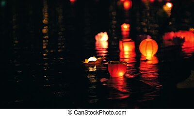 Festival of floating lighting Lanterns on river at night