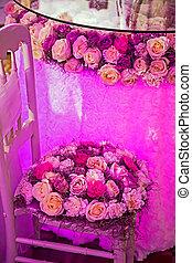 Festive arrangement with flowers and romantic lights