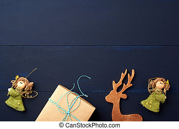 Christmas decor on a blue wooden background from boards