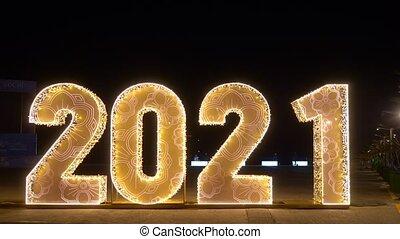 festive background. figures 2021 With sparkling golden garland.