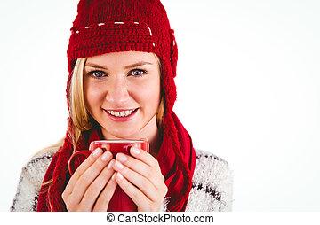 Festive blonde holding a mug