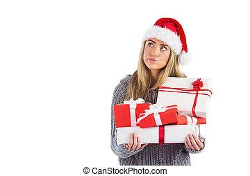 Festive blonde holding pile of gift