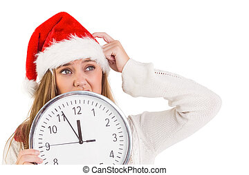 Festive blonde showing a clock