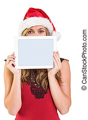 Festive blonde showing a tablet