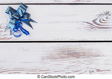 Festive blue gift bow with copy space.