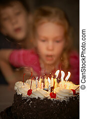 Festive candles blow out on a birthday cake - Birthday of...