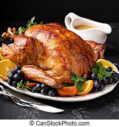 Festive celebration roasted turkey for Thanksgiving -...