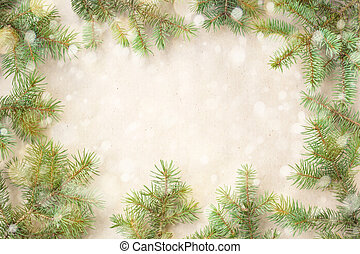 Festive christmas border with fir branches and snowflakes with snow on rustic beige background
