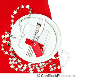 christmas table place setting decoration in red and silver