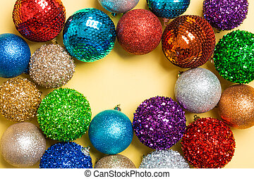 Festive composition of decorative baubles on colorful background. Top view of Christmas toys with copy space