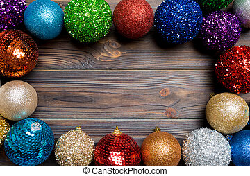 Festive composition of decorative baubles on wooden background. Top view of Christmas toys with copy space
