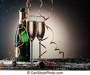 Festive composition with open bottle of champagne and filled...
