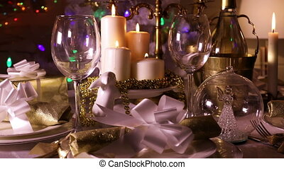 Festive dining table with lighted candles