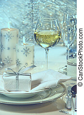 Festive dinner setting with gift for the holidays